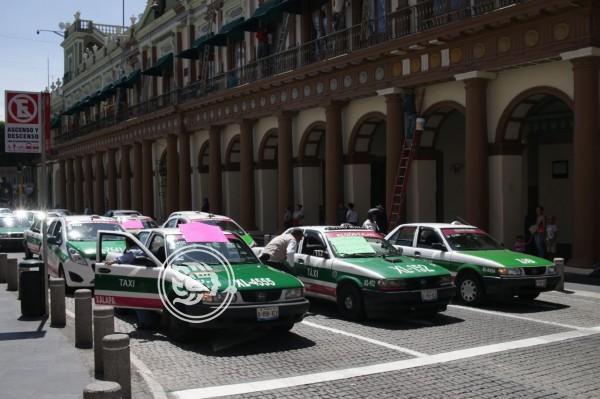 Revocarán 80 concesiones a taxistas ligados a delincuencia en Veracruz